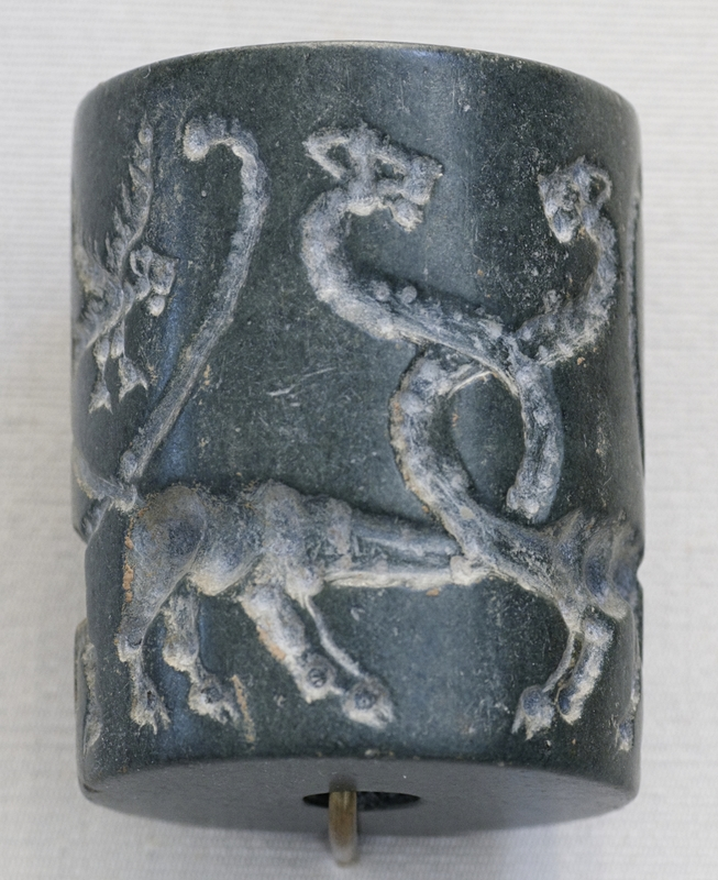 Sceau-cylindre: lions monstrueux et aigles à tête de lion
